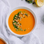 Spicy Sweet Potato Peanut Soup with Kale Pesto